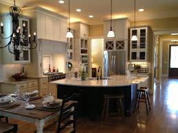 kitchen a dining table with a chandelier the left and then a