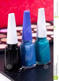 three different nail polish colors and a make up background