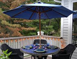 orange patio umbrella with lights also black frame placed on the