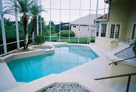 modern swimming pool with exterior tile floors u0026 french doors in
