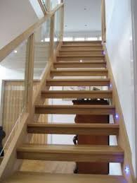 white oak in natural oil and open tread staircase with drywall