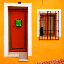 yellow house with red door and green mailbox press