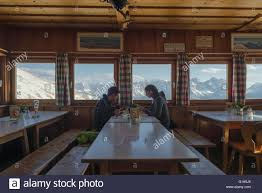young couple eating dinner in the tölzer hut dining room with the