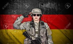 The Germany Flag Soldier Salutes The Germany Flag On The Background Stock Photo