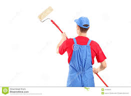 paint man man in a uniform painting a wall stock photo image of pose