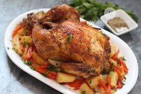 cuisiner un poulet roti poulet rôti au four sur lit de légumes