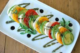 avocado caprese salad with pepita mint pesto nourishrds