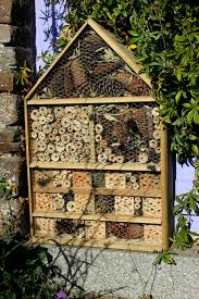 home made repurposed wood luxury insect hotel or five star bug