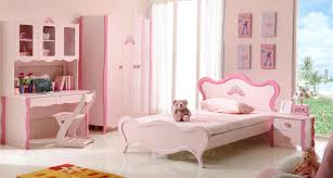 white wood bed with pink headboard connected by pink wood desk and