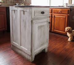 down to earth style re purposed cabinet to mobile kitchen cart