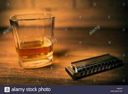 whiskey photography bourbon whiskey and blues harmonica stock photo royalty free