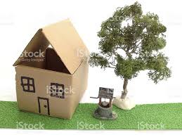 image of cardboard dolls house model wishing well and tree stock