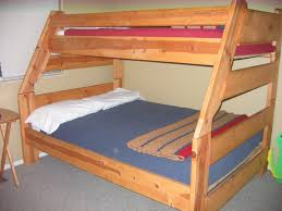 Simple Wooden Bed Frame Brown Wooden Bed With Blue Bed Sheet On Grey Carpet Of Stunning