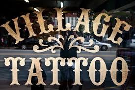 village tattoo parlor shop in downtown romeo michigan village