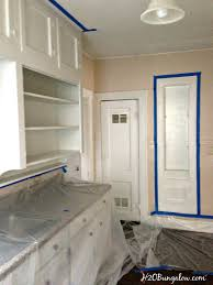 How To Stain Unfinished Cabinets by How To Strip Paint Off Kitchen Cabinets And Furniture