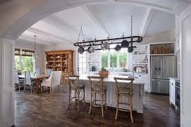 oval pot rack over center island transitional kitchen