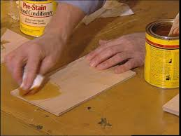Refinishing Kitchen Cabinets With Stain How To Stain Wood Cabinets How Tos Diy