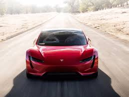 tesla supercar concept tesla roadster speeds in front of electric truck financial tribune