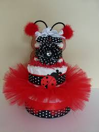 this cute pink and red diaper cake is a perfect gift for the baby