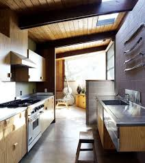 sle kitchen designs interior elevations concrete floor wood cabinets stainless steel countertops