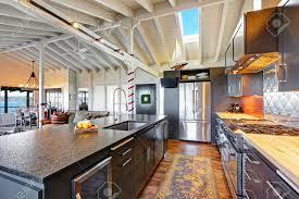 luxury beautiful dark modern kitchen with vaulted wood ceiling luxury beautiful dark modern kitchen with vaulted wood ceiling hardwood floor and huge stove