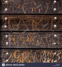 carved wood plank wooden wall on southend pier covered with carved graffiti stock