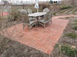 Stone Patio Images by Red Brick Stone Patio With Oval Grey Wooden Table And Chair With