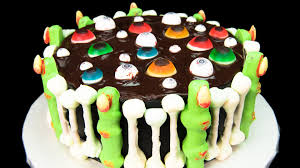 sugar cookie fingers halloween floating eye balls halloween cake with skeleton bones and bloody