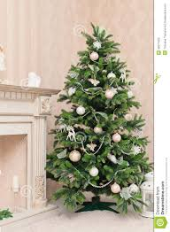 christmas tree with white ornaments in vintage interior stock