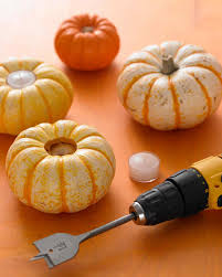 mini pumpkin carving ideas pumpkin votive holders martha stewart