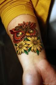 owl head and sunflower tattoo on wrist tattoo designs tattoo