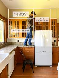 kitchen wall cabinet height options farmhouse kitchen adding a shelf below our cabinets