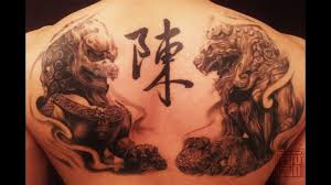incredible fu dogs artist wang of tattoo temple tattoo