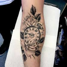picture of roses with clock tattoo on the arm