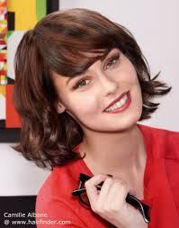 medium hairstyles flipped up layered bob with flipped up ends for a fresh and energetic look
