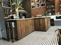 The counter behind which is the pizza oven Picture of Harlem