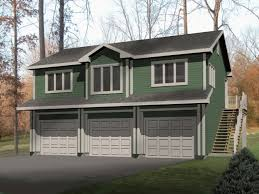 very large garage apartment with one bedroom is built over three