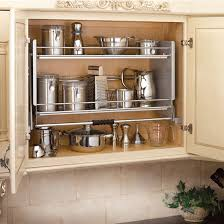 shelf for kitchen cabinets rev a shelf premiere pull down shelving system for kitchen wall
