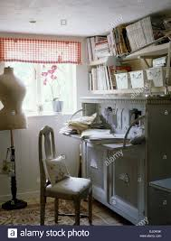 tailor u0027s dummy in small sewing room with painted cabinet below