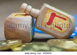 hanukkah dreidels colorful hanukkah dreidels and gold gelt on the table stock photo