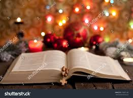 christmas bible blurred candles light background stock photo