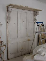 Homemade Headboard Ideas by Headboard That We Made Using Old Salvaged Doors And Porch Columns