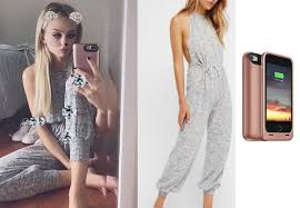 s one jumpsuit bushnell s one jumpsuit and pink cell phone on