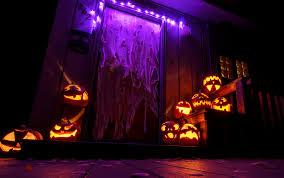 Halloween Lights On House Fantastic Halloween House Decor With Jack O Lanterns Decorations And Purple Lighting On The Door Jpg