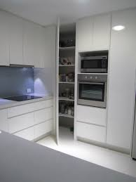 extensive white corner pantry with l shaped open storage elegant