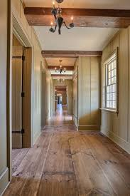 wide plank wood flooring interior hallway colonial