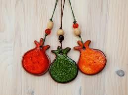 ceramic pomegranate ornament orange green orange