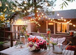 unify separate backyard spaces with string lighting small