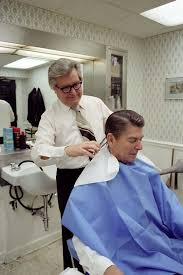 president ronald reagan getting a haircut from milton pitts in the