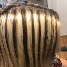 blonde hair with chunky highlights hairstylist transforms bad highlights into platinum blonde before